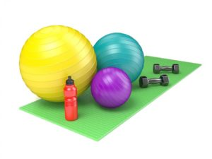 http://streaming.yayimages.com/images/photographer/djmilic/e95a15ad5a158df028b185b16bfac154/fitness-ball-dumbbells-and-plastic-water-bottle-on-green-yoga-m.jpg
